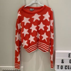 red oversized sweater w white star details